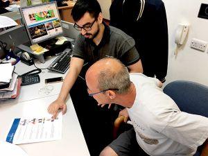 Advance Apprentice Admin Officer Richardo with customer Tony
