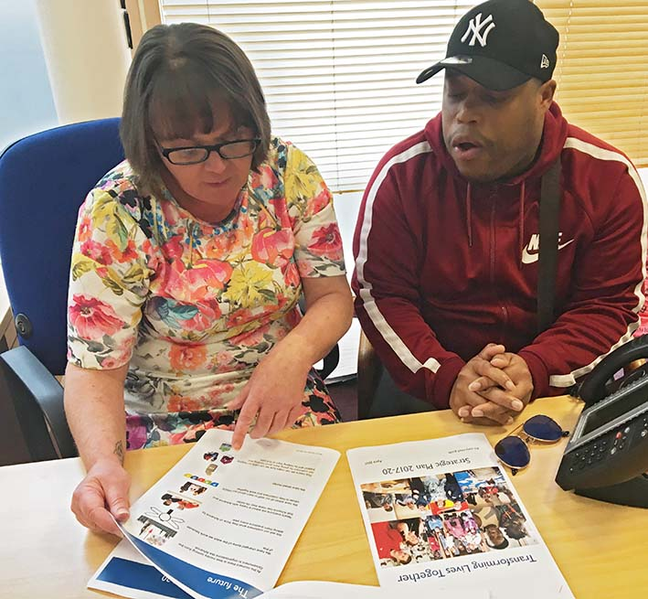 Advance Office Co-ordinator Tracy looks through the plan with customer Nathan