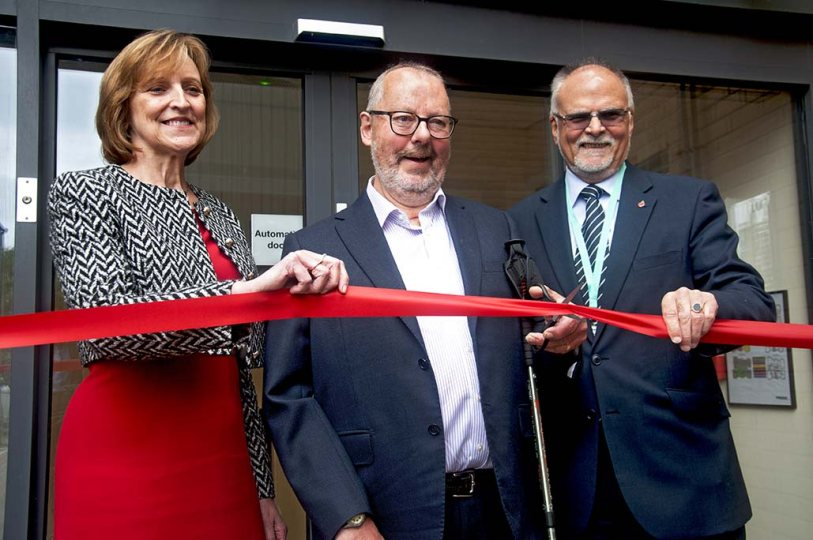 Julie Layton, CEO, former CEO Stuart Rigg and Cllr Lawrie Stratford cut the ribbon