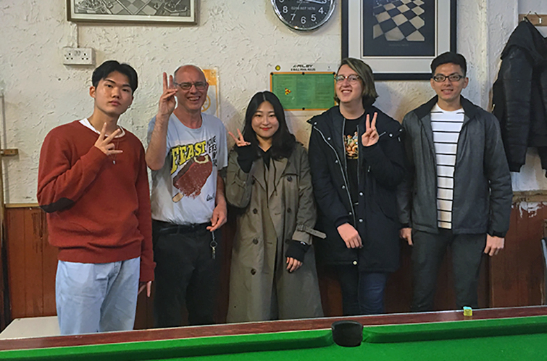 Volunteers play pool in Hackney