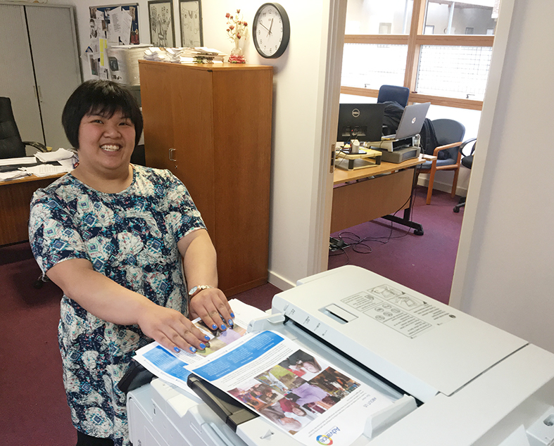 Tuu Mi helps out in the Hackney office every Tuesday with support from her staff team.
